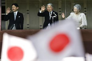 Emperor Akihito (centre), with Empress Michiko and Crown Prince Naruhito, waving to well-wishers celebrating the Emperor's 83rd birthday at the Imperial Palace in Tokyo on Dec 23 last year. He turns 84 next month.