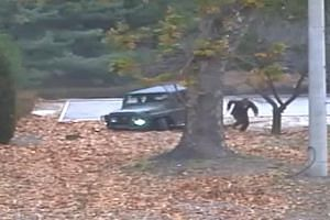 2 THE CHASE The defector is pursued by North Korean soldiers, with their weapons drawn and firing. 3 THE WOUNDED The soldier, having been shot at least four times by his former comrades, lies injured on the ground. 4 THE RESCUE He is later pulled to
