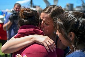 A relative of one of the 44 crew members of Argentinian missing submarine, is comforted outside Argentina's Navy base in Mar del Plata.