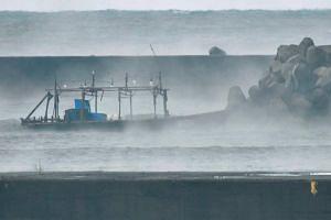 A wooden boat is seen in front of a breakwater in Yurihonjo, Akita Prefecture, Japan, on Nov 24.