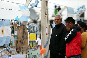 Signs and messages in support of the 44 crew members of the missing ARA San Juan submarine on the perimeter fence of the Mar del Plata Naval Base in Argentina on Thursday.