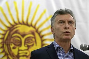 Macri speaks during a press conference, after a meeting with the high command of the Argentine Navy.