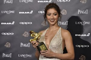 Taiwanese-Lebanese actress Rima Zeidan poses after winning the Best New Performer award for the film Missing Johnny, at the Taiwan's 54th Golden Horse film awards in Taipei on Nov 25, 2017.