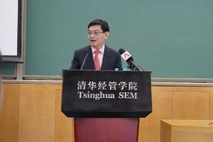 Finance Minister Heng Swee Keat giving a speech at Tsinghua University on Saturday (Nov 25).