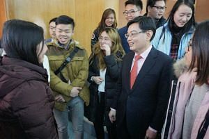 Finance Minister Heng Swee Keat interacting with Singapore students studying at Tsinghua University after his speech on Saturday (Nov 25).