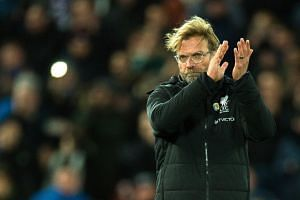 Klopp (above) said he was happy with Liverpool's performance.