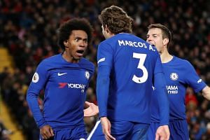 Chelsea's Willian celebrates scoring their first goal with Marcos Alonso and Cesar Azpilicueta.