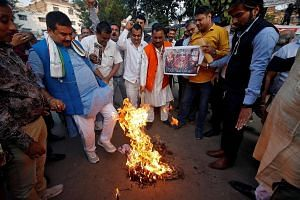 People burning an effigy of director Sanjay Leela Bhansali at a protest against the release of the movie, Padmavati, in Kolkata, on Wednesday. In the controversial movie, Rajput queen Padmavati was played by superstar Deepika Padukone, whose life has
