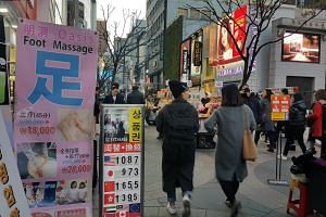 A massage advertisement spotted in the heart of Myeongdong, Seoul.
