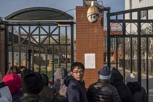 A crowd gathers outside RYB Kindergarten in Xintiandi, in eastern Beijing.