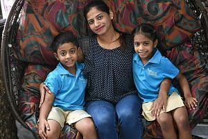 Above: Cassidy Low, six, attends the MOE kindergarten co-located with Northoaks Primary, while sister Lesley, four, will start K1 there next year. Left: Ms Premlatha Selvaraj, with her son Shivanesh, six, and daughter Nivashini, five, who attend the