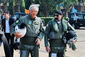 Dr Ng Eng Hen accompanied by Indian Air Vice-Marshal A P Singh as they prepare to board the Indian Air Force's Tejas Light Combat Aircraft , on Nov 28, 2017.