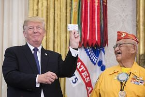 President Donald Trump with Thomas Begay, a Navajo Code Talker, during an event at the White House in Washington, on Nov. 27, 2017.