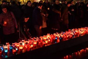 Bosnian Croats and residents of Mostar, light candles in in tribute to General Slobodan Praljak, on Nov 29, 2017.