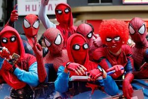 Fans dressed in Spider-Man costumes waiting to catch a glimpse of cast members at the Japan premiere of Spider-Man: Homecoming, in Tokyo on Aug 7, 2017