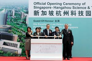 Prime Minister Lee Hsien Loong officiating during the opening ceremony for the Asendas Singapore Hangzhou Science and Technology Park with Hangzhou Mayor Cai Qi (right) and other dignitaries, on June 5, 2009.
