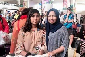 Ms Rukzana Hamid and her daughter Nur Humairah in Surabaya airport.