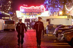 German police patrol the area around a Christmas market in Potsdam after an explosive was found there on Dec 1, 2017.