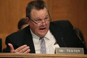"Senator Jon Tester called it ""Washington DC at its worst"" in a video in which he held up a page of the Bill with the changes."