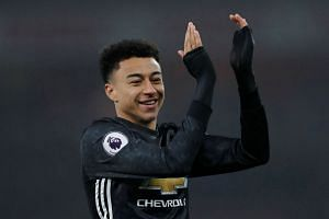 Manchester United's Jesse Lingard celebrates after the match.