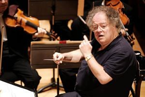 A file photo showing US conductor James Levine and the Boston Symphony Orchestra performing Hector Berlioz's Damnation of Faust during a rehearsal at the Salle Pleyel in Paris, on Sept 4, 2007.