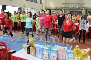 Dr Amy Khor (in teal) joins residents at the Hong Kah North Community Club for an exercise demonstration.