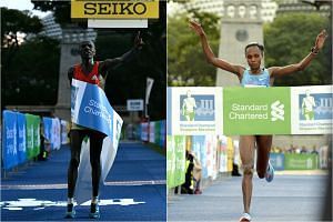 Cosmas Kimutai (left) was the fastest man over the 42.195m course while the women's race was won by Pamela Rotich.