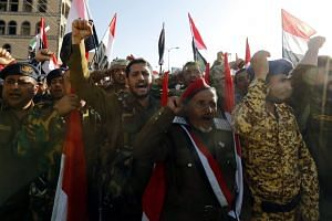 Houthi supporters shout slogans during a rally celebrating the death of Yemeni ex-president Ali Abdullah Saleh, Dec 5, 2017.