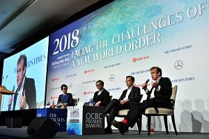 (From left) Moderator Irene Tham, ST's senior technology correspondent; Singapore's defence cyber chief and chief executive of the Cyber Security Agency (CSA) David Koh; Mr John Lee, president of the ISACA Singapore Chapter; and Mr Richard Skinner, p