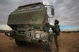 Corporal First Class Mohamed Farhan Mohamed Anwar getting into his HIMARS vehicle during Exercise Forging Sabre.