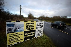 A sign from Border Communities Against Brexit is seen on the borderline between County Cavan in Ireland and County Fermanagh in Northern Ireland near Woodford, Ireland on Nov 30, 2017.