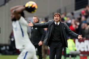 Chelsea manager Antonio Conte reacts as Victor Moses takes a throw in.