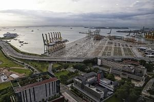 The multi-billion dollar project at Tuas will increase the port's capacity to 65 million TEUs (twenty-foot equivalent units) of cargo - more than double what the port handled last year.