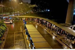 The queue for shuttle buses towards Choa Chu Kang in the evening on Dec 10, 2017, the first of two scheduled full-day closures of certain stations on the East-West Line and North-South Line.