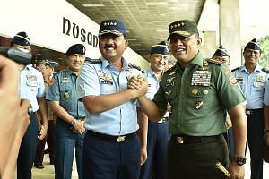 Air Chief Marshal Hadi Tjahjanto (left) has been sworn in as Indonesia's new armed forces chief, taking over from General Gatot Nurmantyo, who will reach the official retirement age of 58 in March next year.