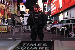 A policeman stands guard in Times Square, New York, near the site of the pipe bomb explosion.