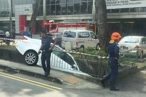 A 67-year-old woman was taken to hospital after accidentally driving her vehicle into a drain in Bukit Timah on Dec 13, 2017.