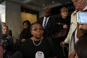 Marcia Willis-Stewart, a lawyer representing families involved in the Grenfell Tower fire, speaks to the press on the first day of the public inquiry into the disaster in central London, Britain, on Sept 14, 2017.