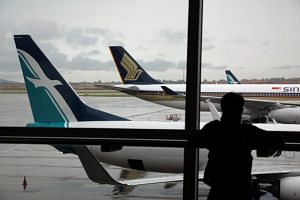 SilkAir and Singapore Airlines planes are seen on the tarmac at Changi Airport on Oct 4, 2017.