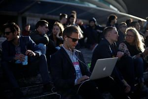 A man using his laptop during the Web Summit, Europe's biggest tech conference, in Lisbon, on Nov 8.