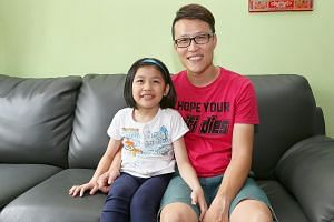 Mr Chew Tuck Choy with his daughter Zecia, who has Gaucher disease. Most of the family's savings are spent on her treatment, which is paid for with the help of government aid.
