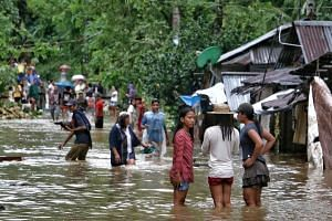 Tens of thousands were driven from their homes by floods as Tropical Storm Kai-Tak pounded the eastern Philippines, cutting off power and triggering landslides.