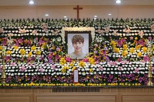 The portrait of Kim Jong Hyun is seen on a mourning altar at a hospital in Seoul on Dec 19, 2017.