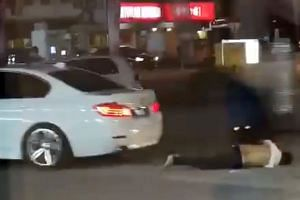 Screengrabs from video footage showing the victim being run over by the assailants' car before it sped off. The victim, who was assaulted and stabbed, died.
