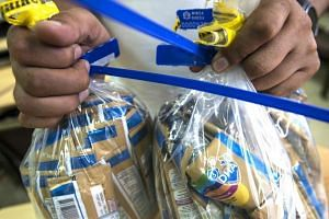 Samples of baby formula imported from the French group Lactalis and sold under the local brand Gloria Stage 3 are sent to a lab at the Ministry of Health in Lima on Dec 11, 2017.