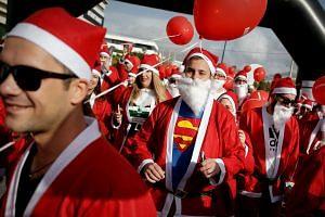 People dressed as Santa Claus taking part in a Santa Claus Run in Athens, Greece, last week.