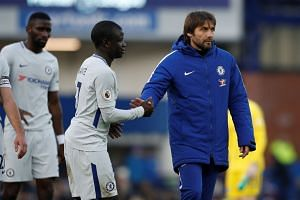 Chelsea manager Antonio Conte shakes the hand of N'Golo Kante after the match.