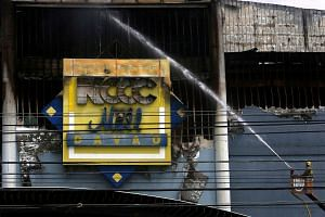 The fire at the NCCC mall in Davao killed 38 people on Saturday, including a mall safety officer who was trying to rescue those trapped in the blaze.