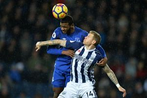 West Bromwich Albion's James McClean in action with Everton's Cuco Martina at The Hawthorns, West Bromwich, Britain on Dec 26, 2017.