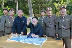 North Korean leader Kim Jong Un inspects the intermediate-range ballistic missile Pukguksong-2's launch test with Kim Jong Sik (second, left), Ri Pyong Chol (third, left) in this undated photo released by KCNA, on May 12, 2017.